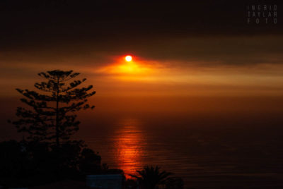 Unfortunate Beauty - Sunset Rendered Vivid by Wildfire Smoke